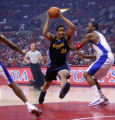 Denver Nuggets guard Andre Miller drives past  Los Angeles Clippers' forward Elton Brand, right, ...