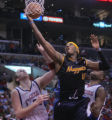 Denver Nuggets forward Carmelo Anthony, middle, splits Los Angeles Clippers defenders Chris Kaman,...