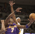 [(Denver, CO, Shot on: 1/12/05)]  Los Angeles Lakers #7 Lamer Odom gets a shot blocked by Denver...