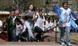 Students from Jefferson High run towards the state Capitol, Wednesday Apr. 19, 2006 as metro area...
