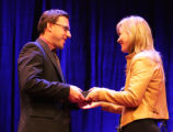 Todd Heisler is given the award by Magdalena Herrera, member of the jury during the World Press...