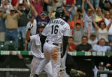 Rockies Ryan Spilborghs, left, joins in with the crowd celebrating Eli Marrero,16, scoring the...