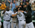 Rockies swarm  Eli Marrero,16, after he scord the winning run in the bottom of the 10th at Coors...