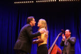 Todd Heisler is congratulated by Magdalena Herrera, member of the jury, while James Colton,...