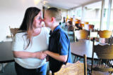 Carolyn Talmadge, cq, rubs noses with her son, Matthew Windgate, cq, 11, at the Crossing, a...
