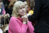 Lynn Pierce(cq) left,  from Aurora, fights back tears  during a Denver DA's office ceremony Monday...