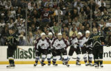 Colorado players head up the ice after their third goal of the first period, shot by Milan Hejduk,...