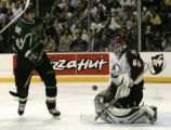 Stars Jason Arnott (44) watches as Avs goalie Jose Theodore makes a third period stop during game...