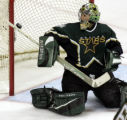 Stars goalie Marty Turco deflects a second period shot during game two of the NHL playoff series...