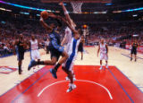 Denver Nuggets forward Carmelo Anthony is defended tightly by Los Angeles Clippers' players Chris...