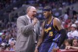 Denver Nuggets head coach George Karl, left, has words with forward Carmelo Anthony, right, in the...
