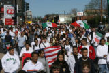 Thousands of students march down down Speer to the State Capitol to support efforts to defeat...