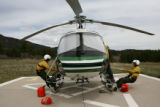 Monument Helitack crew members (lt-rt) Scott Bogges, cq, and Steve Mosies, cq, practice their...