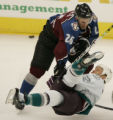 JPM142   The Mighty Ducks of Anaheim Todd Marchant gets upended by  Colorado Avalanche...