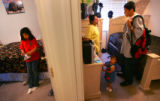 After working all night Enedina Martinez talks to her oldest son Alejandro Martinez, CQ, 14,...