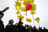 Debbra Parker, cq, of Lakewood releases a red balloon Apr. 25, 2006 in memory of her son Clint...