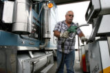 Kenneth Carpenter, cq, of Omaha, NE., puts the nozzle back on the pump after fueling up Tuesday...