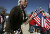 Bill Hedberg, Lakewood, (cq), sells all flags and has been selling them for 50 years... An...