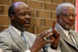 Rev. Willie Simmons, cq, speaks at a new conference as Pastor Paulk Burleson listens, held by the...