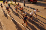 Competitors in the 2004 Pikes Peak Marathon race up Ruxton Avenue towards the entrance to Barr...