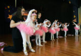 (NYT25) NEW YORK -- May 4, 2006 -- NY-GIRL-BALLERINAS-2  -- Ballet students are assisted by...
