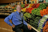 Business profile of Wild Oats President and CEO Perry D. Odak in the produce isle on of his stores...