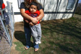 Yesenia, CQ, 20, who is considered an illegal immigrant, plays with her son Gael Najera, 2, at a...