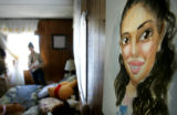 A character rendering of Alejandra, 17, hangs on her bedroom wall above her bed that holds dozens...