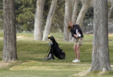 Jenna Zamprelli, (cq), comes out of a tough lie toward the green near the end of her round....