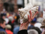 JPM058  Vendor Hollie Burr (cq) holds up a bag of pistachios and peanuts for fans enter the...