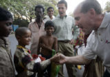 (1/27/05, Chennai, India) David Hoffman plays the thumb game with child street vendors in...