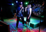 "Corey White (cq), left, and Eve Wilkinson (cq), 28, right, preform karaoke to ""Arms of an..."