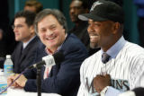 MH103 - Carlos Delgado, right, smiles as he answers questions from the media as Marlins owner...