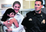 Clint Kell (cq), 25 of Denver, hugs his girlfriend Erin Velasquez (cq), 23 of Denver, after a...