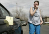 Marisa Melendez (cq), reacts after being ticketed twenty dollars for being parked in front of her...