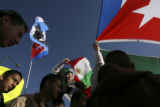 (CENTER TOP) Brandon Martinez (CQ), 13, of Hodgkins Middle School holds a Mexican flag, while...