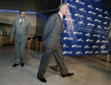 104697.SP.1116.dodgers7.RCG -- The Los Angeles Dodgers owner Frank McCourt, right arrives at a...