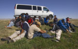 17 Illegal immigrants wait on the side of Eastbound I70 while Colorado State Patrol Master...