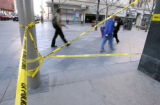 Pedestrians pass by the scene where Denver Police were investigating  a driveby shooting which...