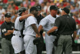 Rockies manager Clint Hurdle argues with home plate ump Travis Reininger, right, after Reininger...