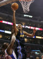 CATG104 - Denver Nuggets' Marcus Camby (23) goes up for a shot against Los Angeles Clippers' Elton...