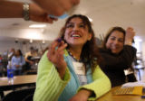 Showing the ink stain voting mark on her middle finger, Rocio De la Cruz Castillo (cq), left,...