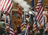 Members of the Northern Colorado Fife and Drum Corps fire their black powder guns at the opening...