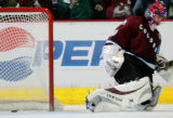 Colorado Avalanche Goaltender Jose Theodore lets the final of three goals slip past him in the...