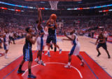 Denver Nuggets guard Andre Miller, middle, is defended tightly by Los Angeles Clippers' players as...
