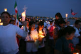 Marchers parade around Sloan's Lake during a candlelight vigil at Sloan's Lake on Monday, April...