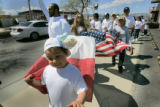 "Joseph Bueno, (cq) 6 shouts ""Yes, we can!' in Spanish as he carries the Mexican flag and his..."