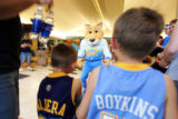 Nuggets mascot Rocky (cq, center) approaches young Nuggets fans Zack (cq, left in Najera jersey)...