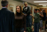 Actress Kristine Blackport, center, rehearses a scene with actor John Hutton, left, for the movie,...