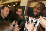 CODZ102 - Denver Nuggets forward Reggie Evans, right, is surrounded by reporters during an...